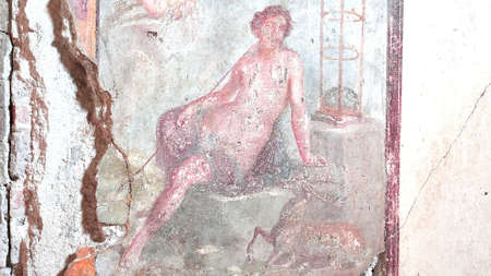 NAPLES, ITALY- JUNE, 13, 2019: fresco of a woman and a deer on a wall at pompeii 新闻类图片