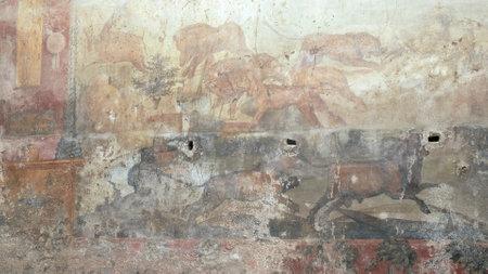 NAPLES, ITALY- JUNE, 13, 2019: hunting scene fresco in the house of ceii at pompeii