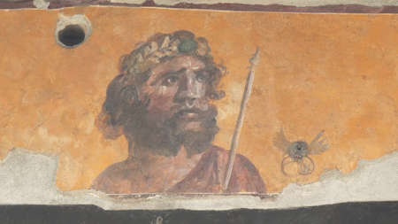 NAPLES, ITALY- JUNE, 13, 2019: fresco of a man on a house wall at pompeii