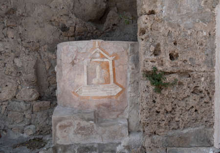 NAPLES, ITALY- JUNE, 13, 2019: phallic symbol on the wall of a house at pompeii- possibly a good luck sign