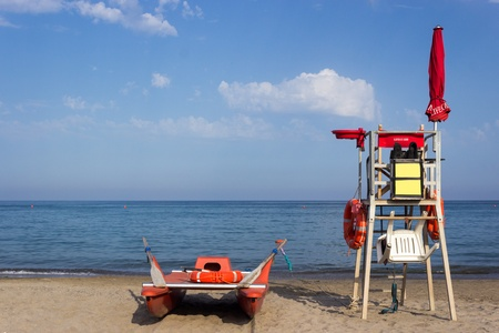 Lifeguard tower and boat, rear view photo