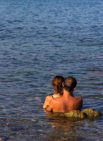 romantic couple in the sea photo