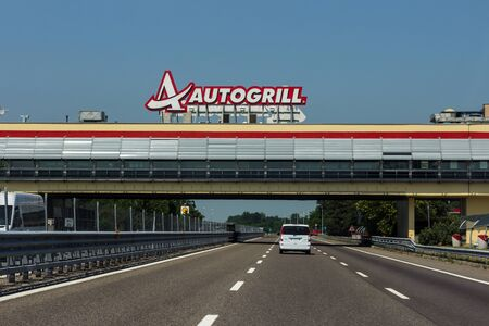 autogrill with sign crosses the highway