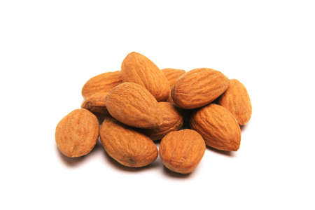 Isolated pile of perfect almonds