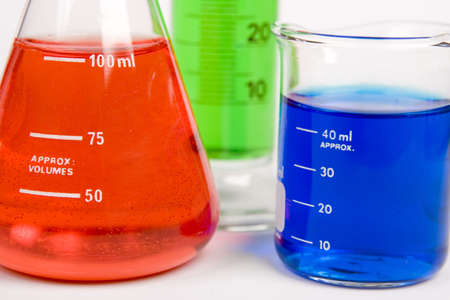 experimentation: Flasks full of different colored liquid Stock Photo