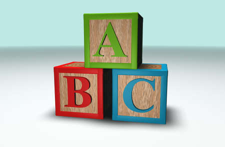 illiteracy: Wooden 3d Abc blocks stacked in a pile Stock Photo