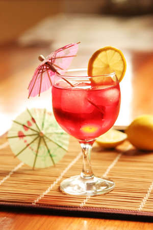 mini umbrella: Cocktail with mini umbrella and lemon slice