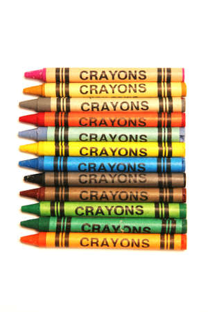 plurality: Colored crayons on a white surface