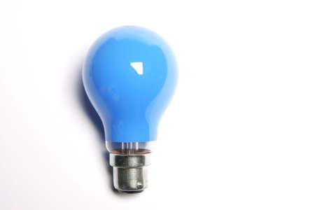 Blue light bulb on white background photo