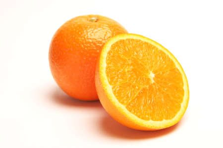 Whole and Half orange on a white background