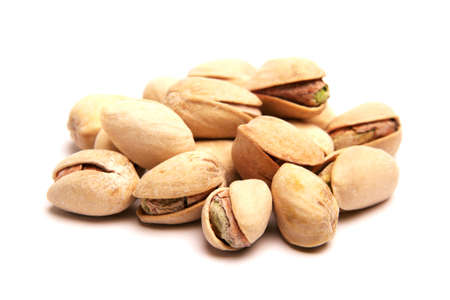 munch: Isolated pistachios on a white background Stock Photo
