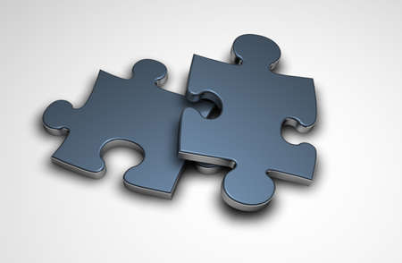Two 3d puzzle pieces one ontop of the other Stock Photo