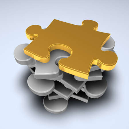 Puzzle pieces in a pile with one gold piece at the top Stock Photo