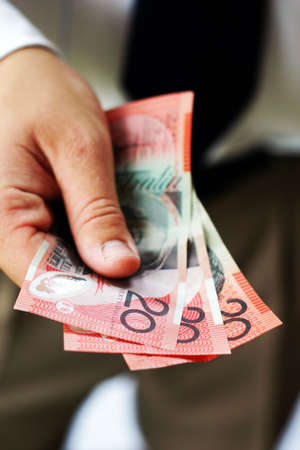 Hand holding australian bank notes