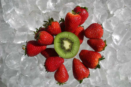 enriched: Strawberries and kiwi fruit on ice