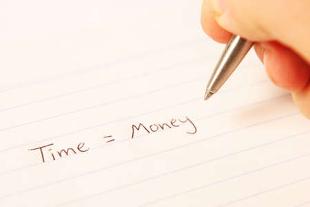 Hand writing time equals money on paper
