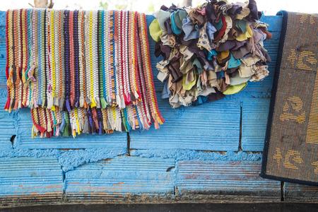 draped: Colourful rugs draped on wall
