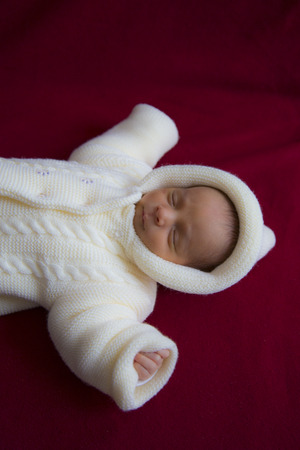 cushioned: Cute baby sleeping in thick cream coat