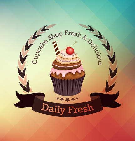 Cupcake with label over colorful geometric background