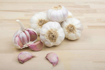 Loose garlic bulb on a wooden background photo