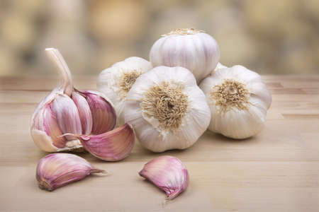 Set of garlic on wooden board with natural background Stock Photo