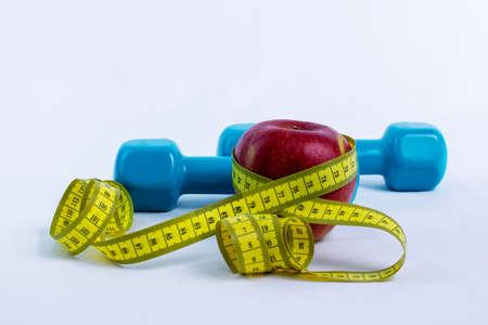 metro de medir: Pesa, manzana y cinta métrica