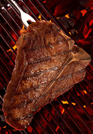 Close Up of a big Steak on a Barbecue