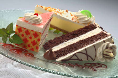 three slices of assorted cakes on a plate
