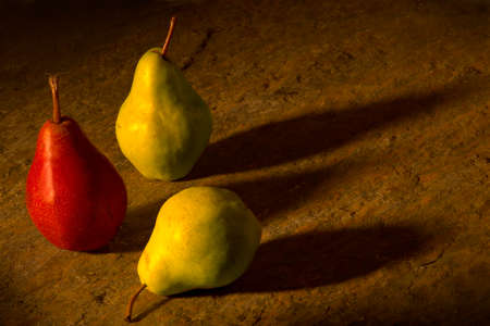 Three Pears on a Table with Shadows Reklamní fotografie