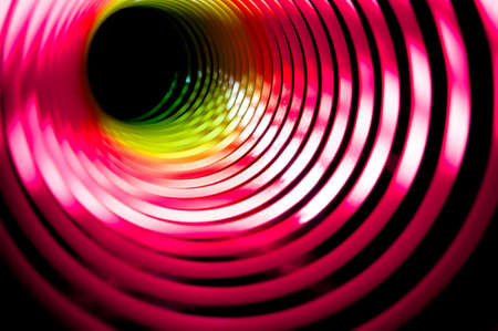 black hole made from a childs coloured spring photo