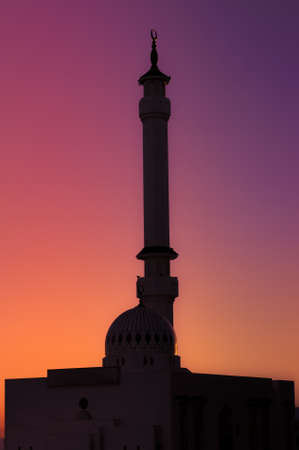 A silhouette mosque with a symbolic sunset- light vs dark - day vs night photo