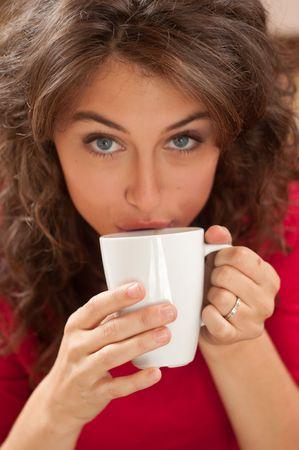 Girl drinking coffee photo