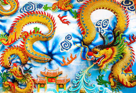 A Chinese dragon on the wall blue cloud stripes photo