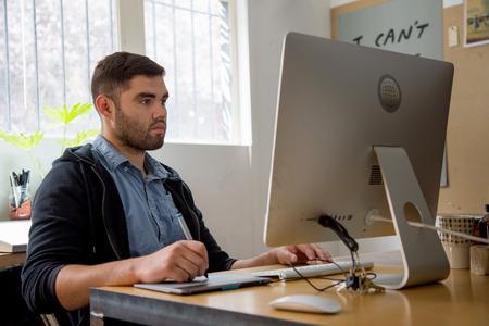 designer: Graphic designer at work