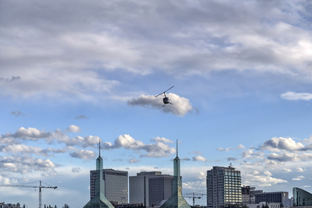 Helicopter and building skyline