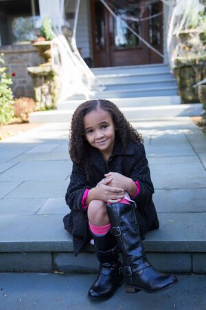 curb: Little girl sitting by the curb Stock Photo