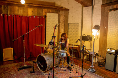 Drummer on set in recording studio
