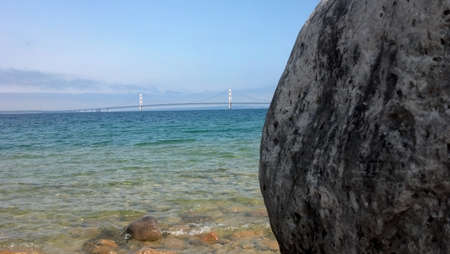 Mackinac Bridge with boulder and Lake Michigan in foreground