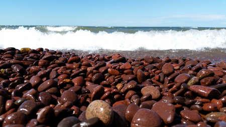 waves crashing: Red rock beach with waves crashing
