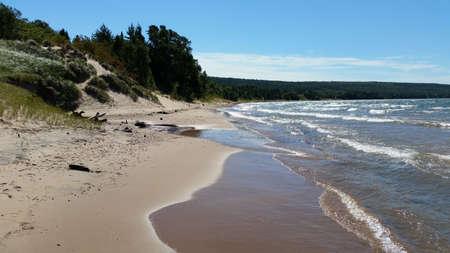 lake beach: Sandy beach with trees Stock Photo
