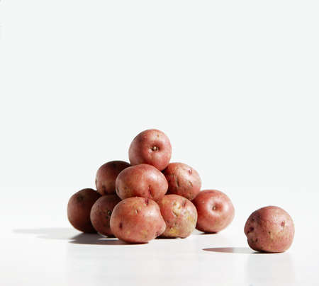 spud: Potato Pile and Lone Spud Stock Photo