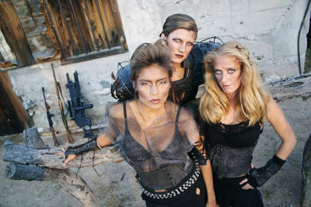 Tough women from the future pose with their weapons. photo