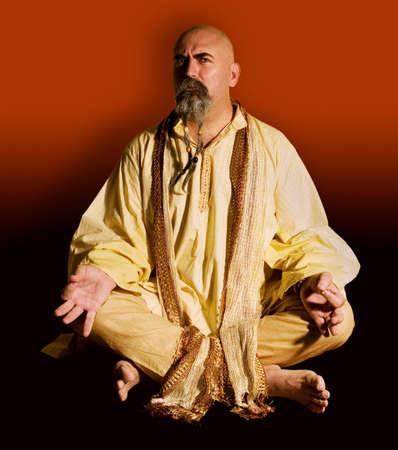 Suspicious guru scowls at the camera.