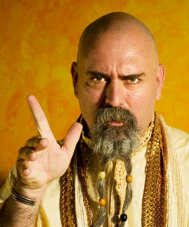 Funny bald guru with a long beaded beard. Stock Photo - 1525932