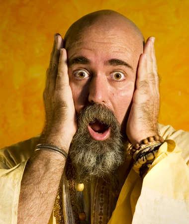 knowing: Funny bald guru with a long beaded beard.