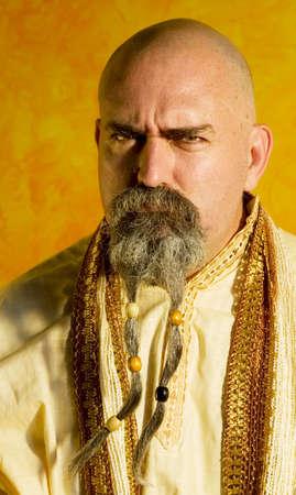 Funny bald guru with a long beaded beard. Stock Photo - 1525935
