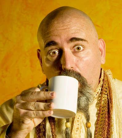 caffiene: Funny bald guru with a long beaded beard.