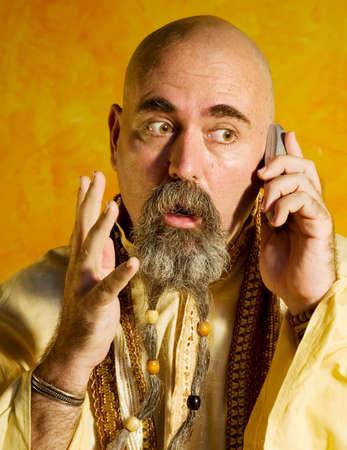 Funny bald guru with a long beaded beard. Stock Photo - 1525934