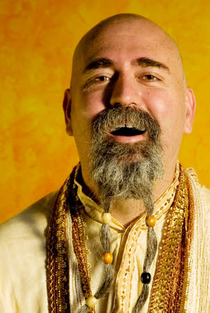 Funny bald guru with a long beaded beard. Stock Photo - 1525927