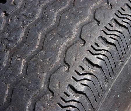 tire tread: Automobile tire with dangerous tread wear pattern.